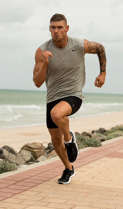 Thomas running along pier in Adelaide beach