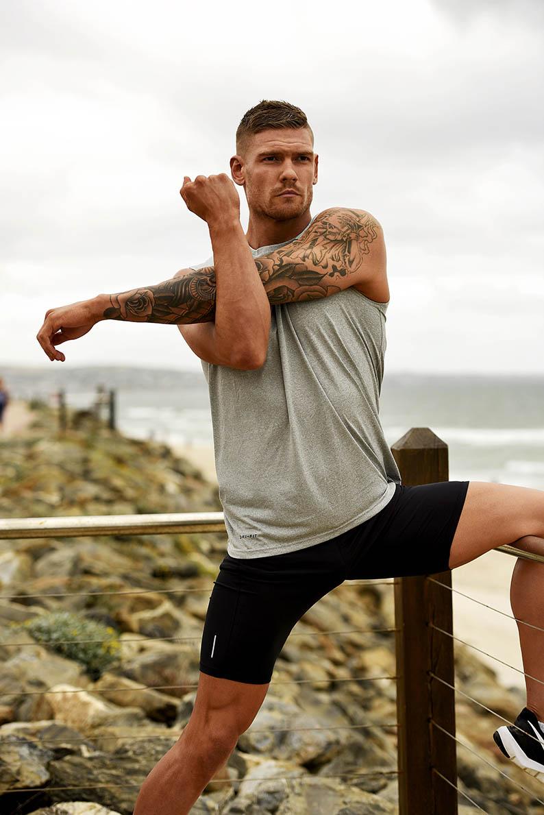 Thomas stretching on Adelaide Beach