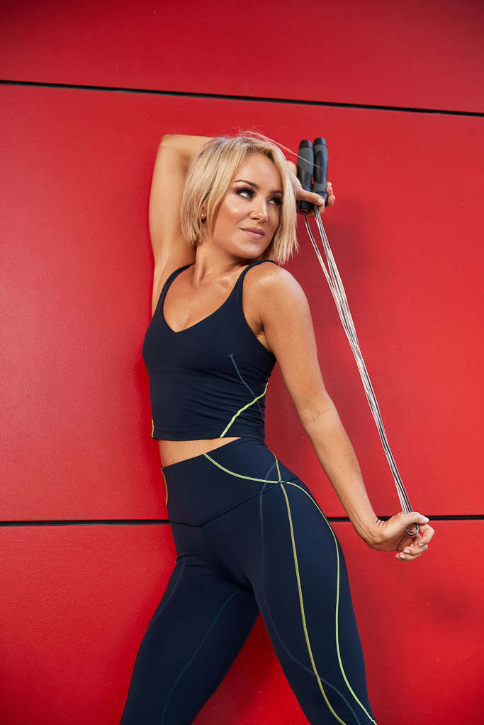 Alexandra Gold Coast Mature female fitness mode stretching with the skipping rope