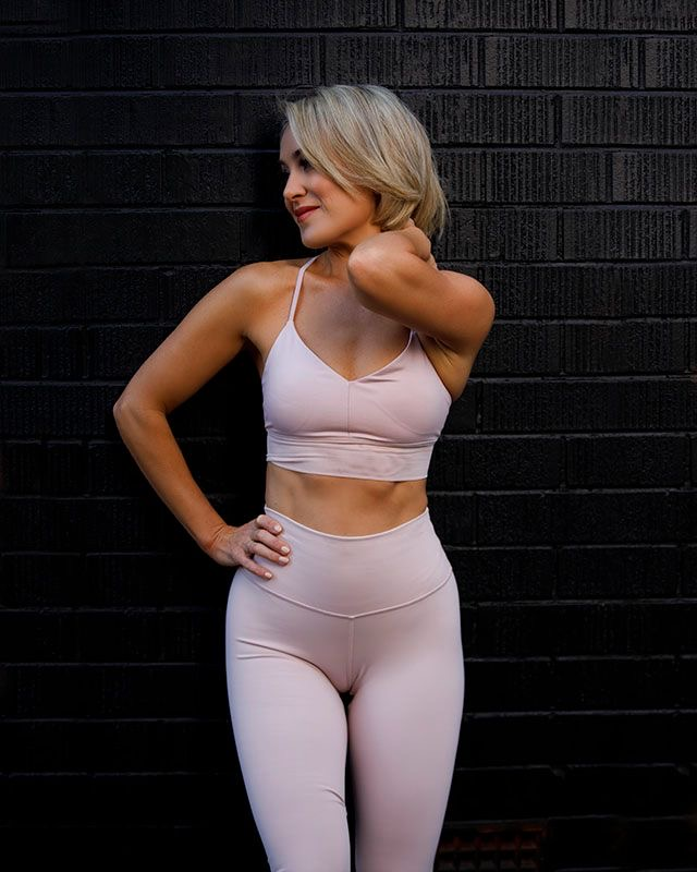 Alexandra Queenland female mature fitness model wearing pink fitness workout gear