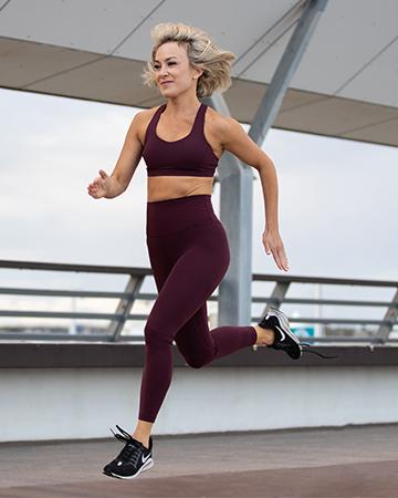Alexandra sprinting on boardwalk in Queensland