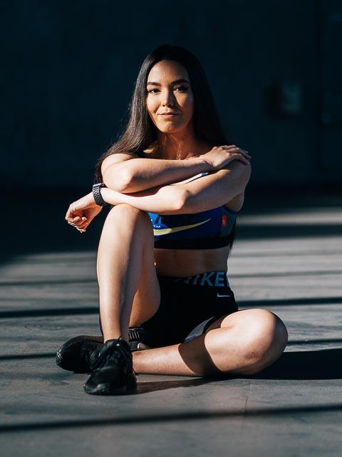 Deborah female elite fitness model seated