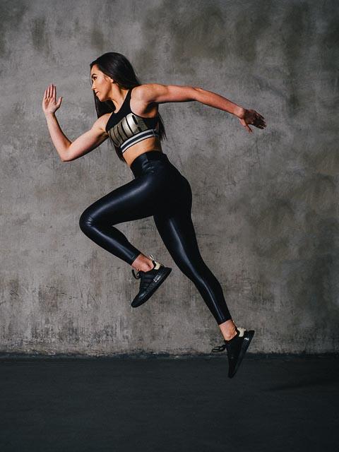 Deborah running wearing puma fashion garment