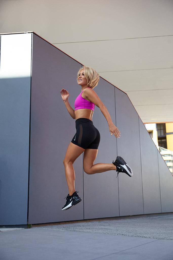 Fitness model Alexandra running during her fitness photo shot
