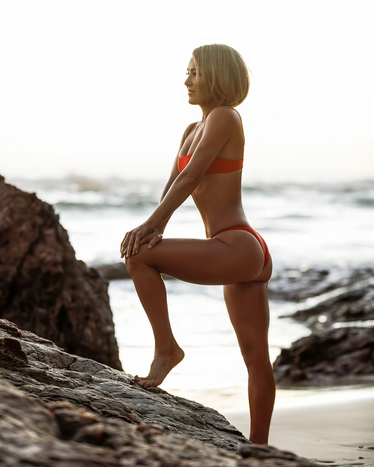 Queensland fitness model posing on the rocks