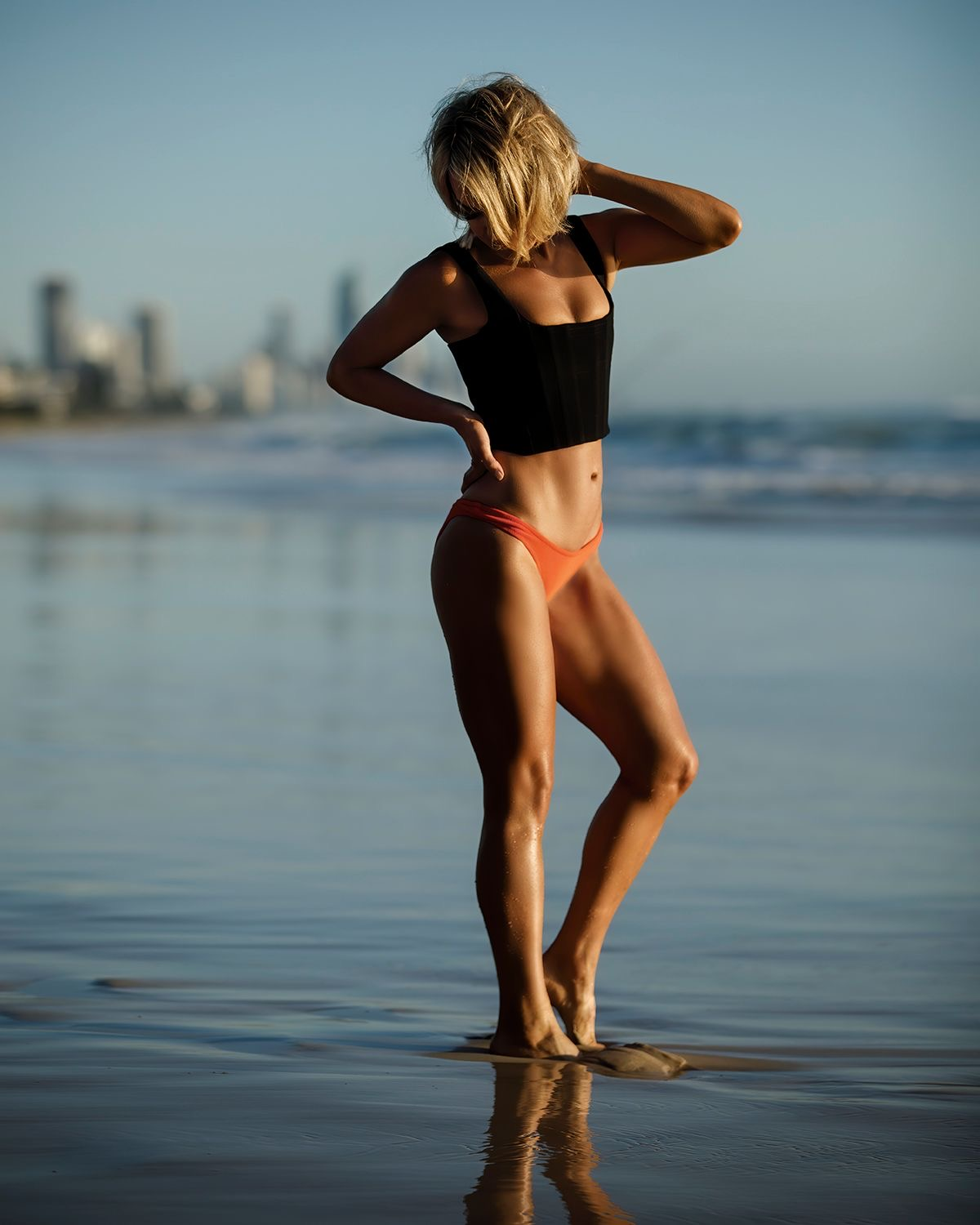 Queensland fitness model posing on the sand