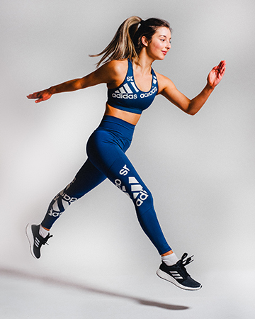 Ravyn running in Adidas blue fitness garment