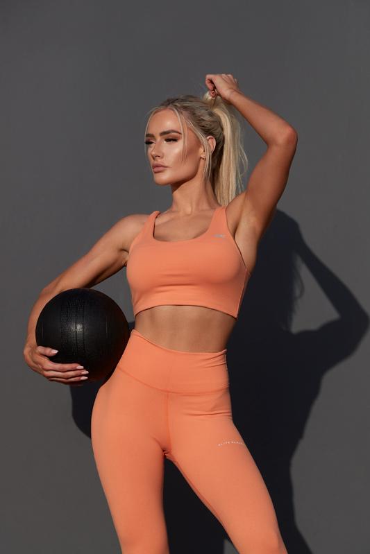 Alex Queenesland blonde female fitness holding medicine ball
