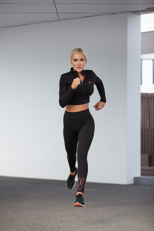 Alex Queenesland female fitness running in black nike outfit