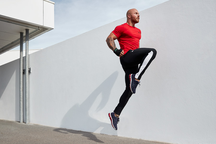 Dylan Queenslands Gold Coast male fitness model performing a jumping knee during his photo shoot