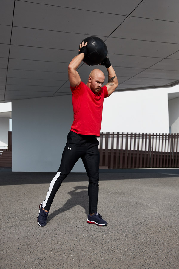 Dylan Queenslands Gold Coast male fitness model slamming a medicine ball