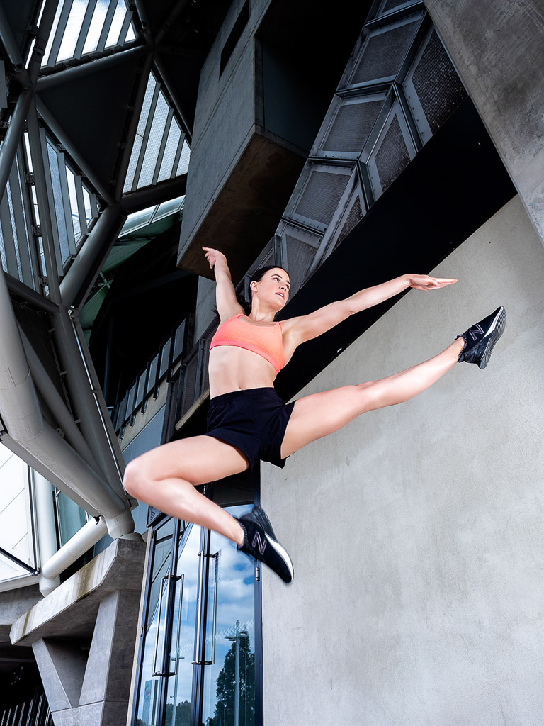 Amy Melbourne Fitness Model and High Level Dancer jumping dynamically 1