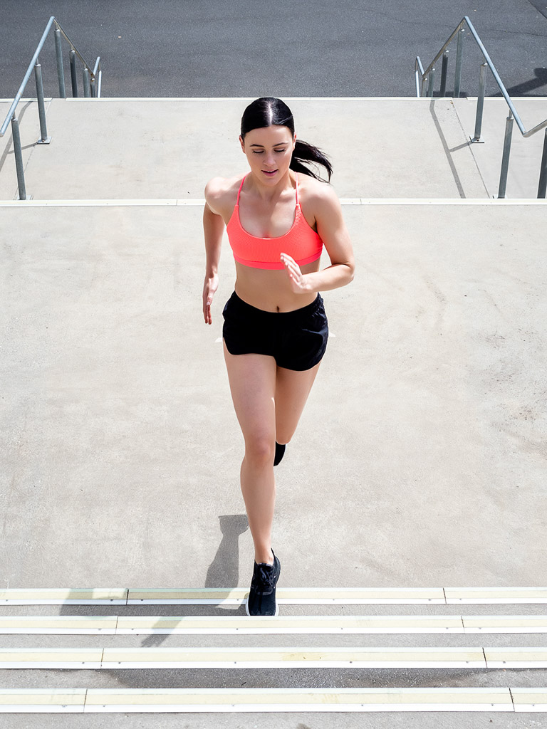 Amy Melbourne Fitness Model and High Level Dancer running up a set of stairs 1