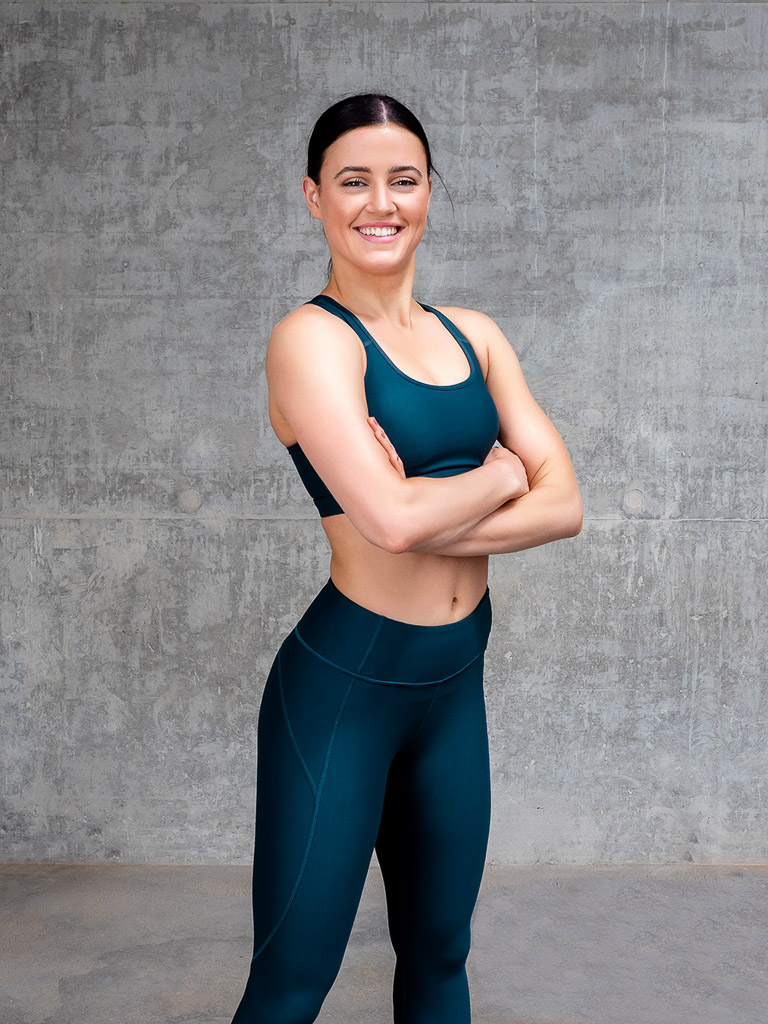 Amy Melbourne Fitness Model and High Level Dancer standing during her portfolio head shot 1