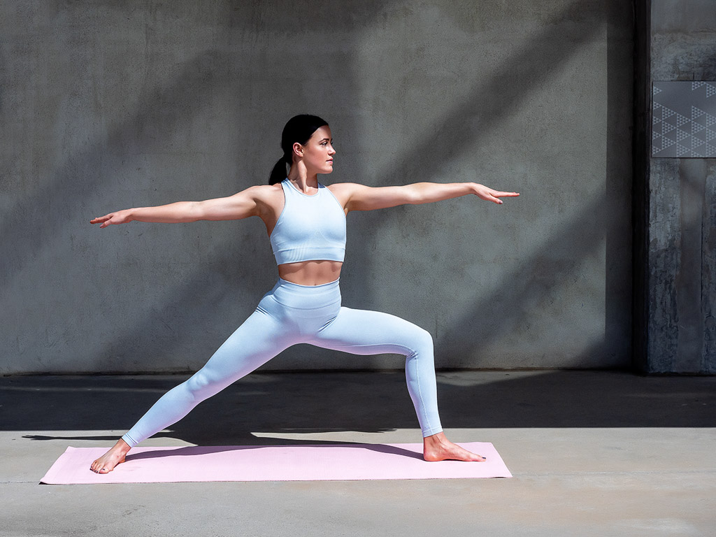 Amy Melbourne Fitness Model and High Level Dancer stretching doing yoga 1