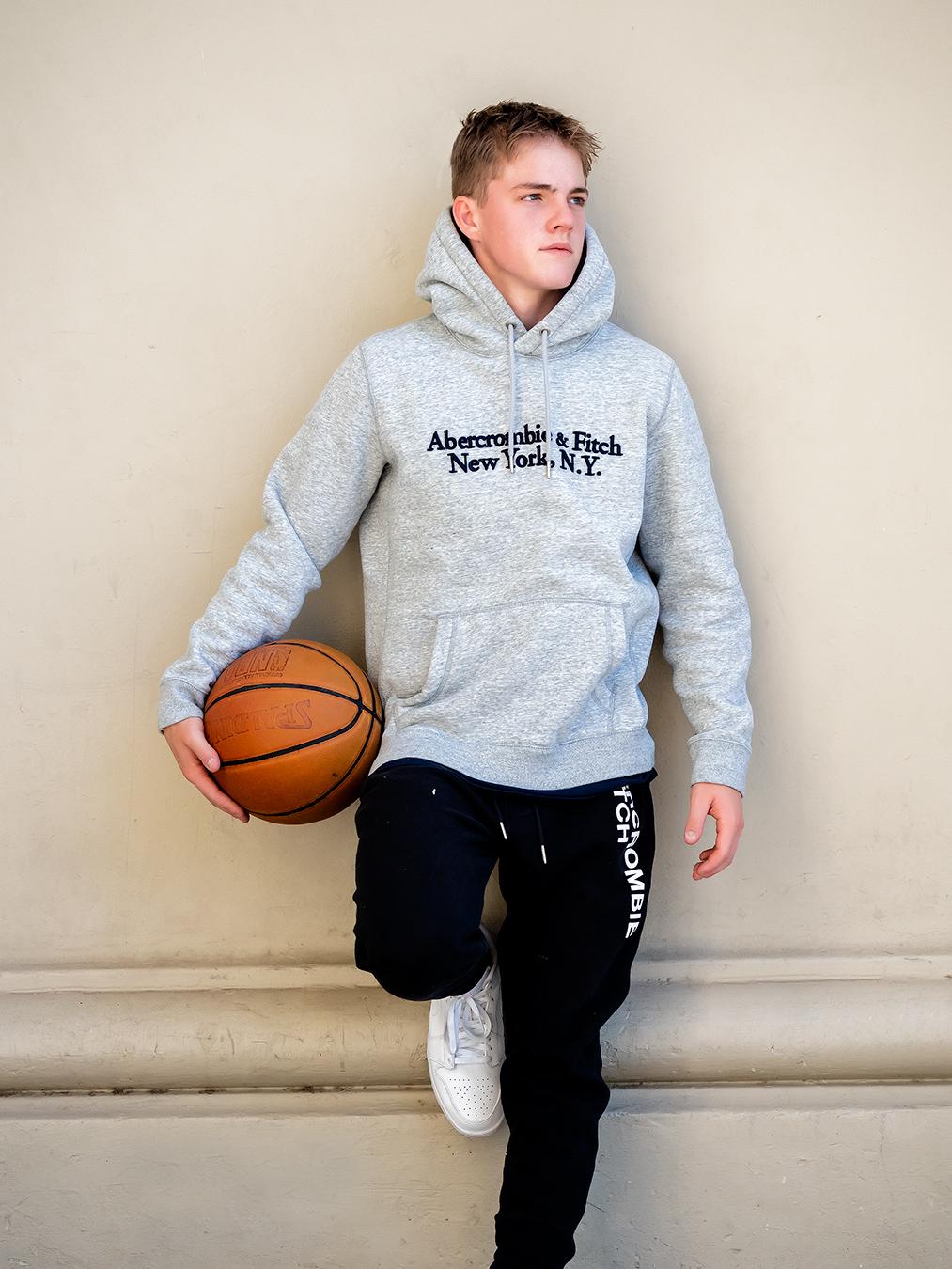 Austin Melbournes teen fitness model holding a basketball