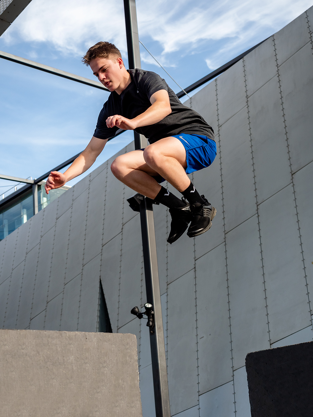Austin Melbournes teen fitness model performing a plyometric onto a concrete step