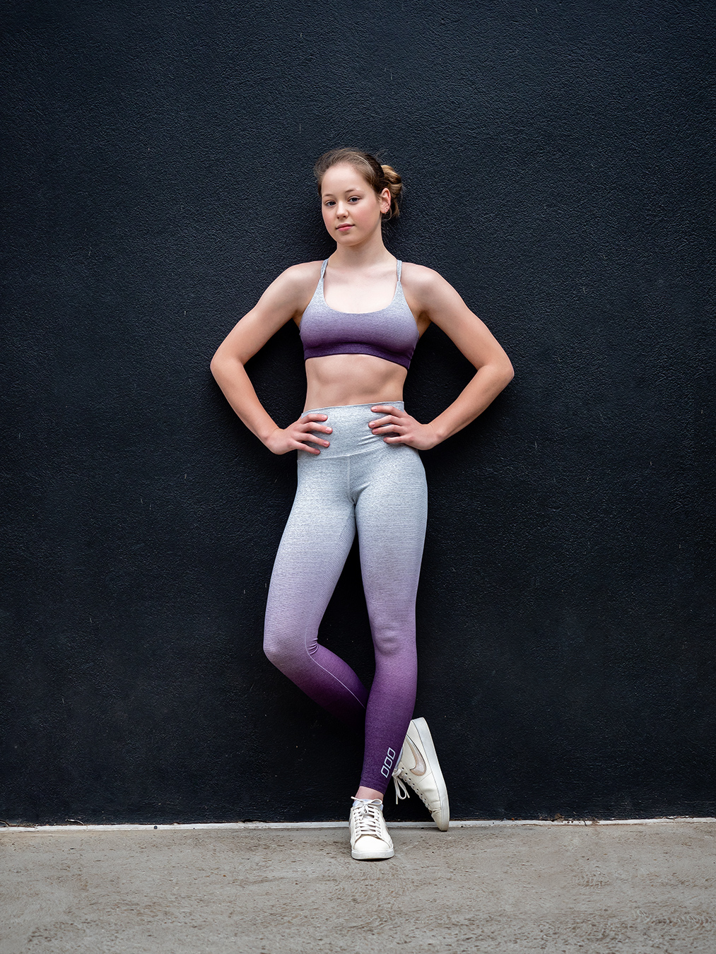 Melbournes Elite Gymnast Alyssa sanding bold legs crossed and hands on her hips