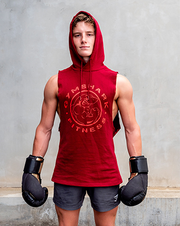 Adelaides up and coming teen model wearing a Gymshark red hoodie and a paid of boxing gloves