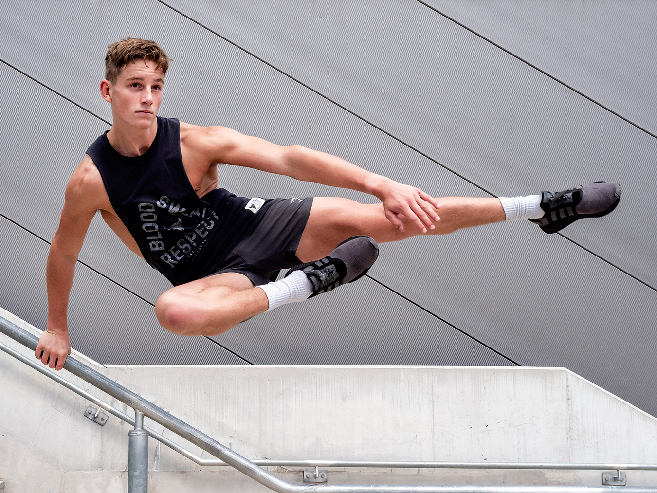 Adelaides young up and coming fitness model Ryan jumping over a wall
