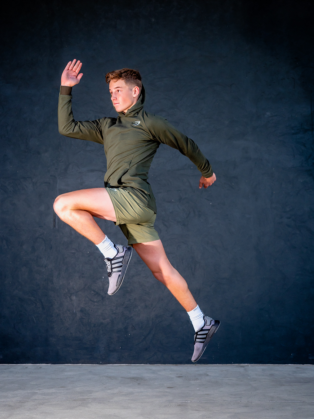 Adelaides young up and coming fitness model Ryan jumping