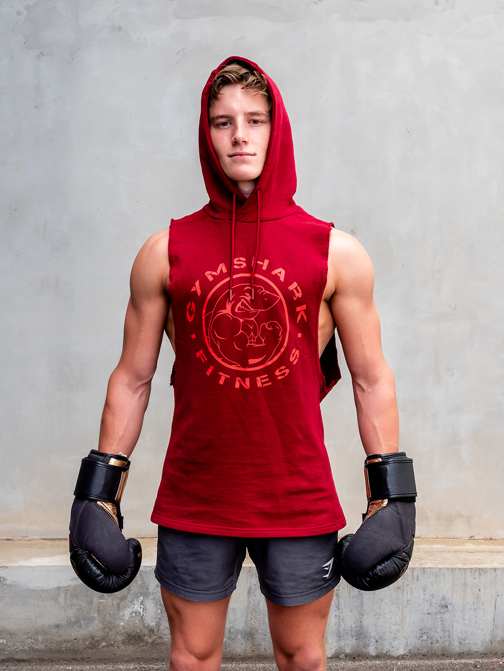 Adelaides young up and coming fitness model Ryan wearing a red gymshark hoodie
