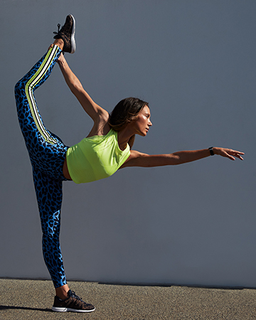 Aiko Queenslands fitness yoga specialist performing the scorpion move 1