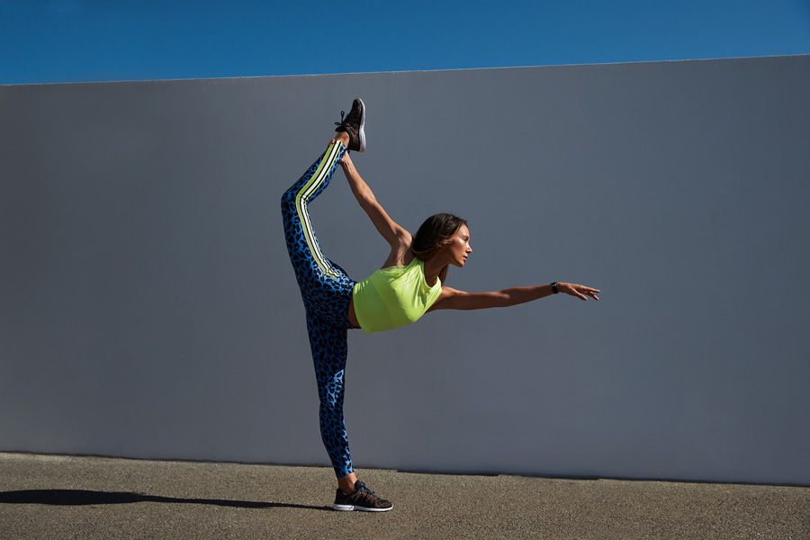 Aiko Queenslands fitness yoga specialist performing the scorpion move