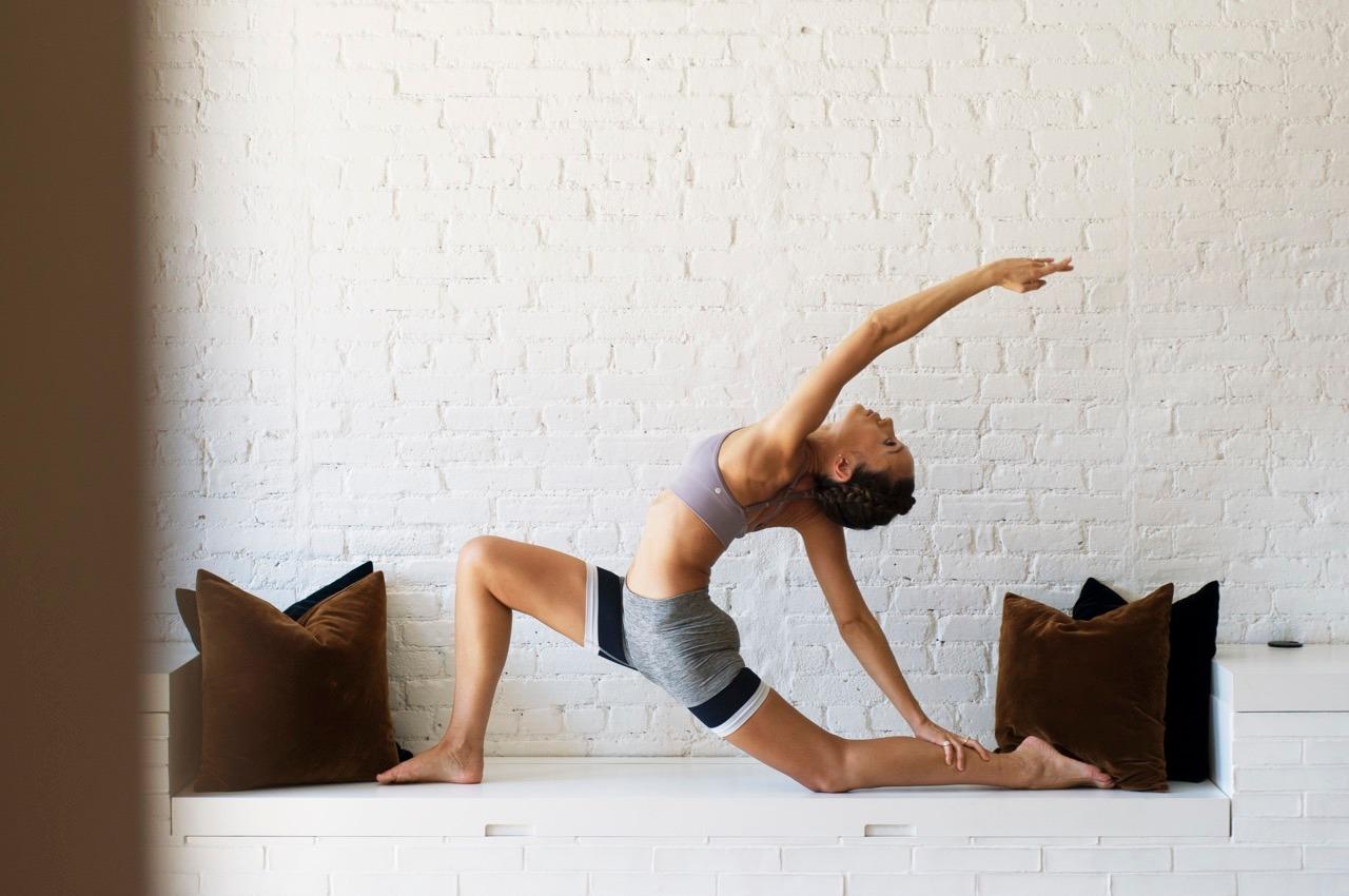 Aiko performing an advanced yoga pose