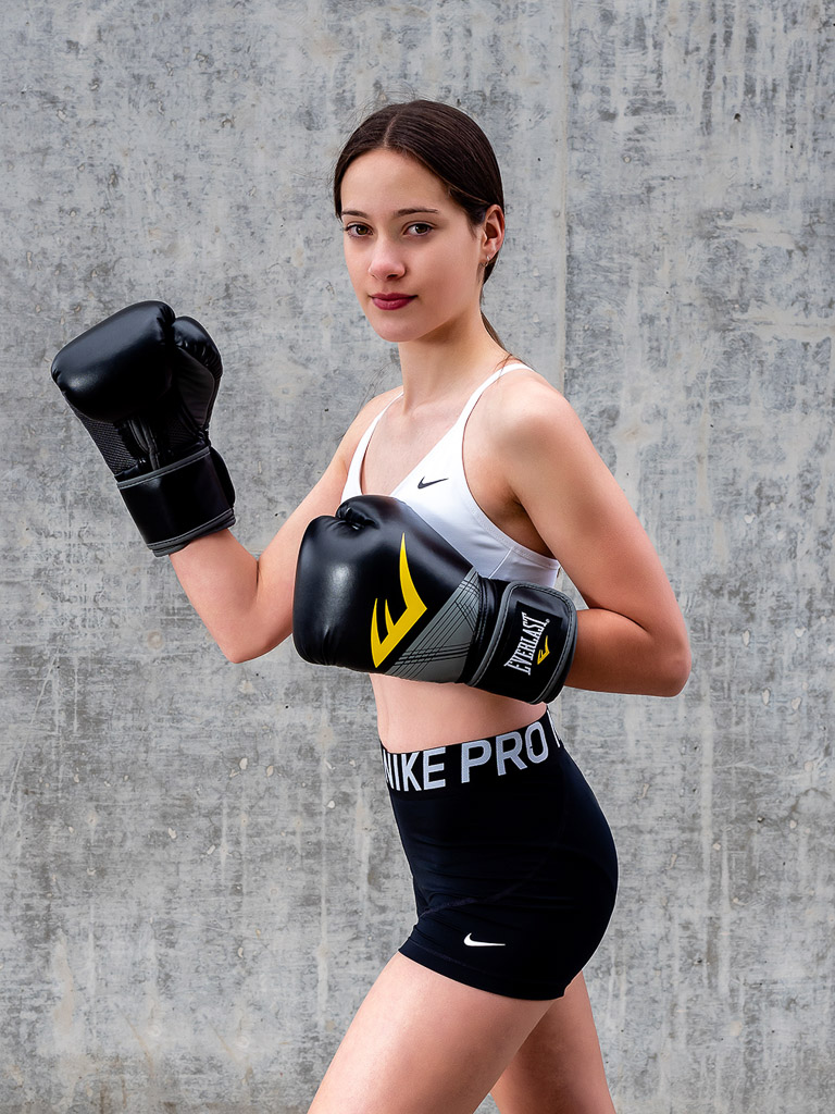 Chloe Melbournes team Fitness Model wearing boxing gloves