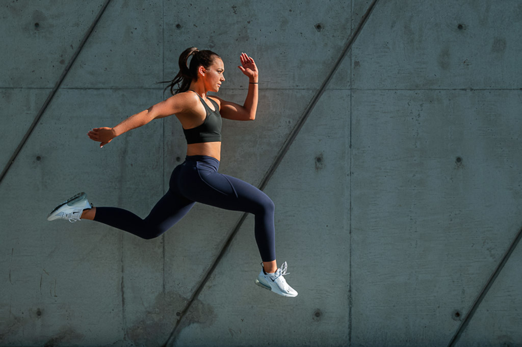 Christine Melbourne young female fitness model bounding