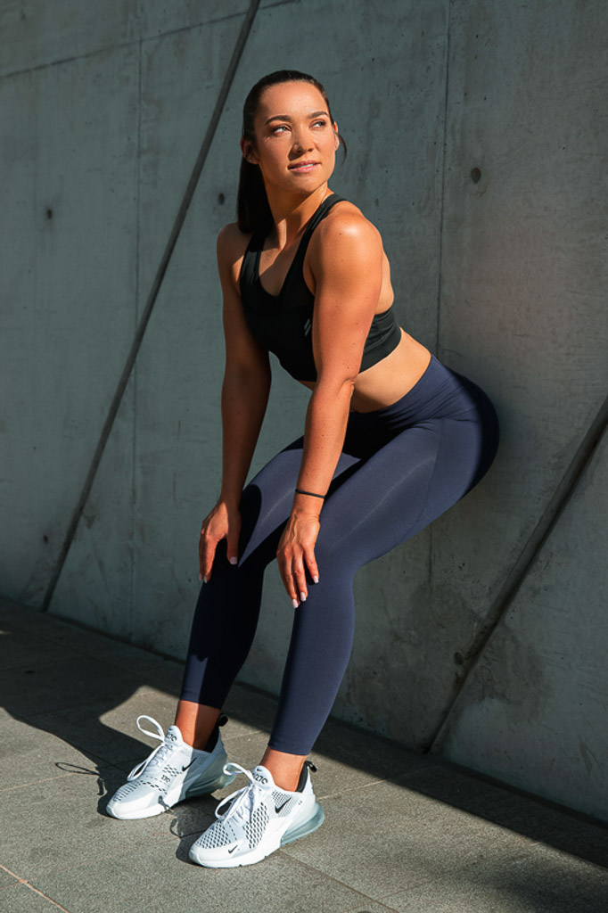 Christine Melbourne young female fitness model leaning against a wall