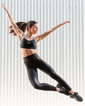 Elly Dancer fitness model flying through the air 1