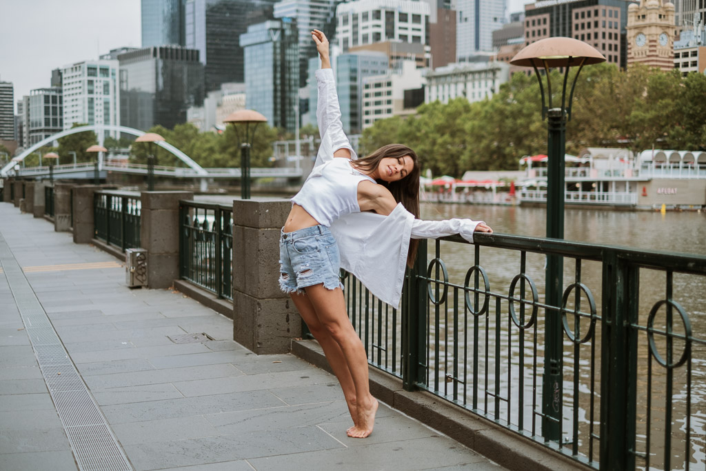 Elly Melbourne young female dancer and fitness model dancing in the city