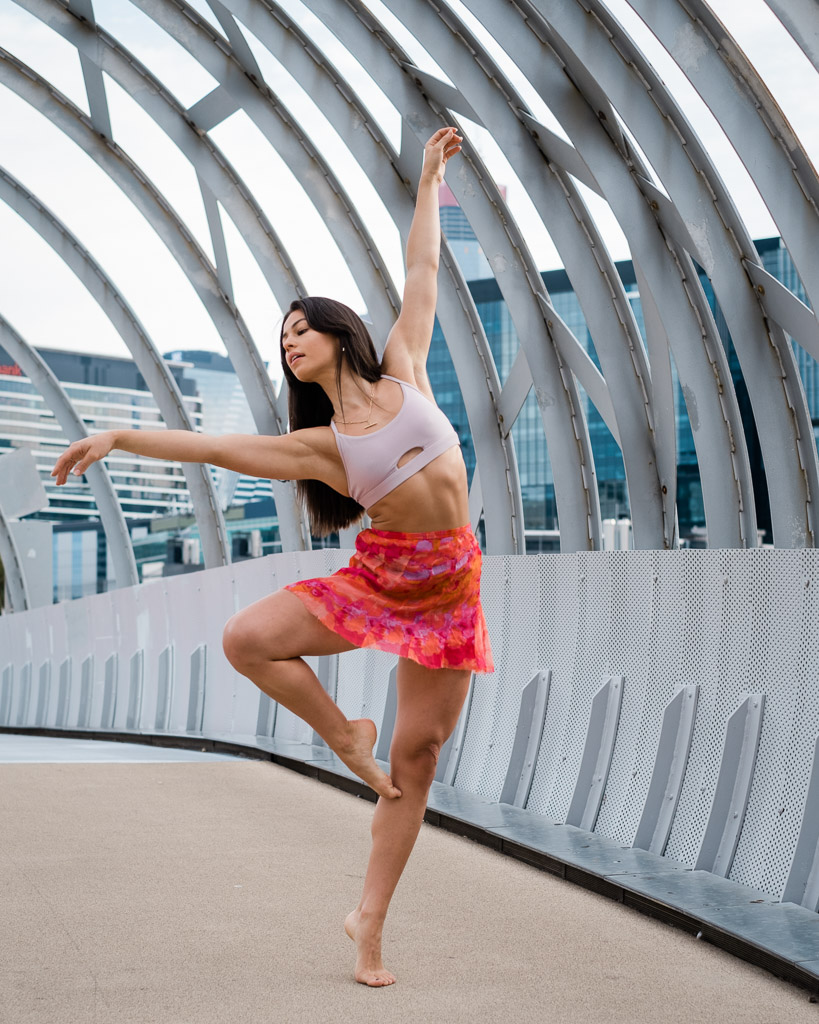 Elly Melbourne young female dancer and fitness model dancing on the spider bridge melbourne