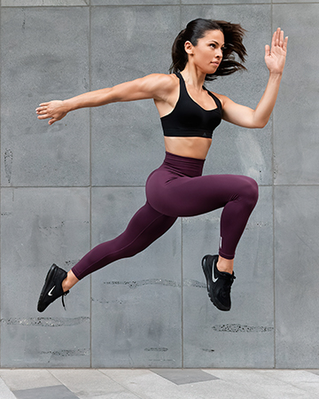 Elly Melbournes young female fitness model jumping