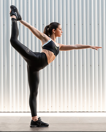 Elly Melbournes young female fitness model performing yoga stretch
