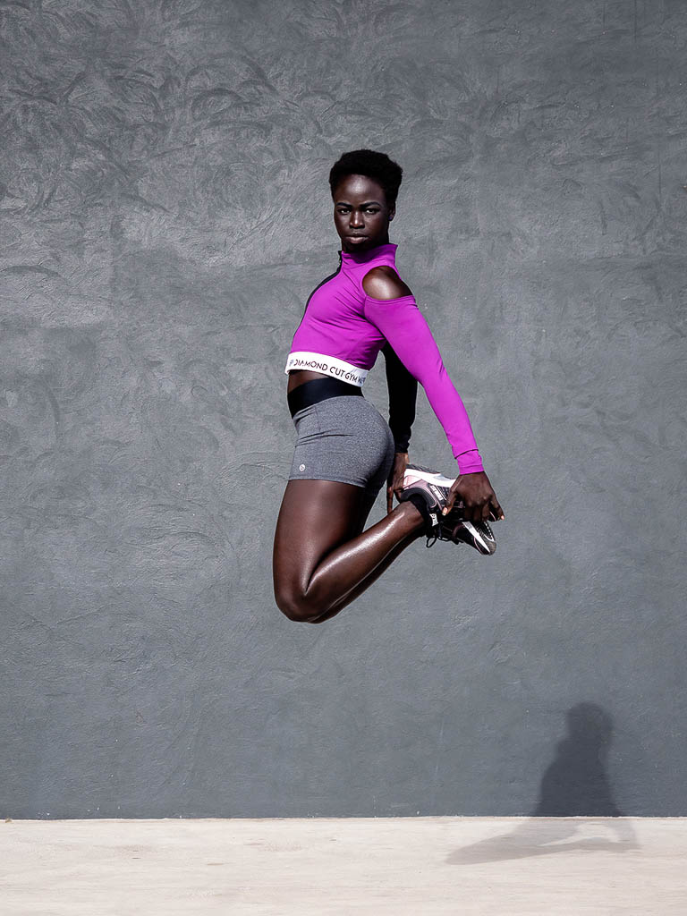 Kim Melbournes black Sudanese model jumping during her fitness shoot