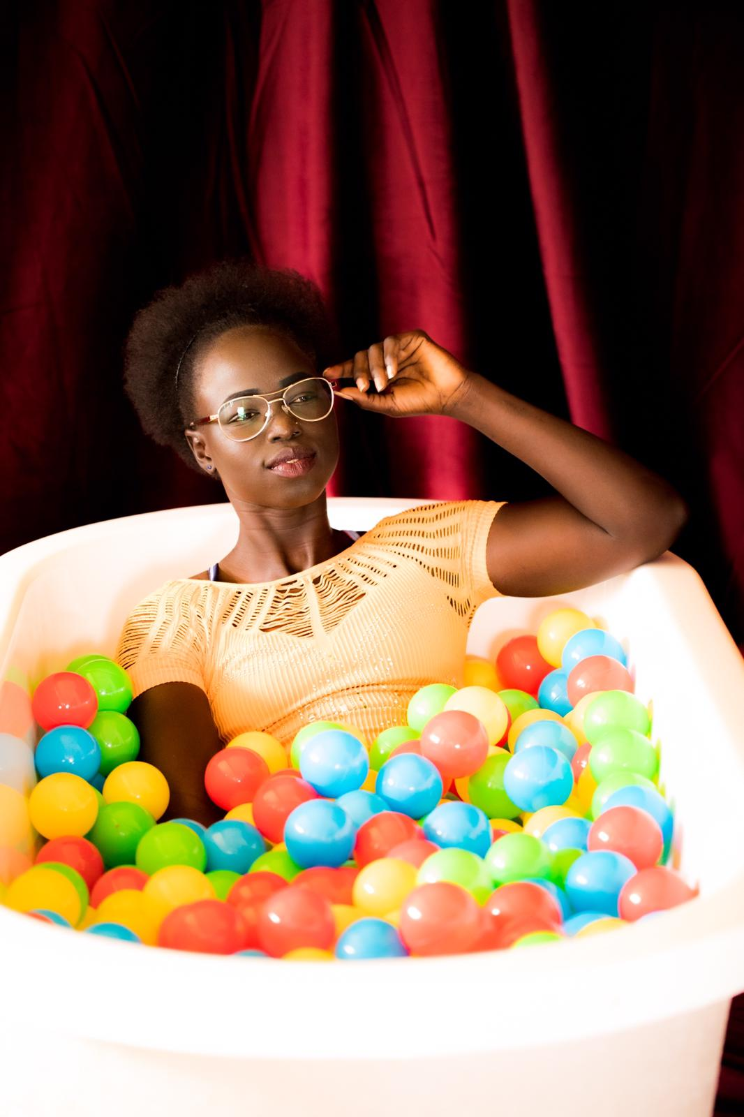 Kimmy in a bath full of coloured balls