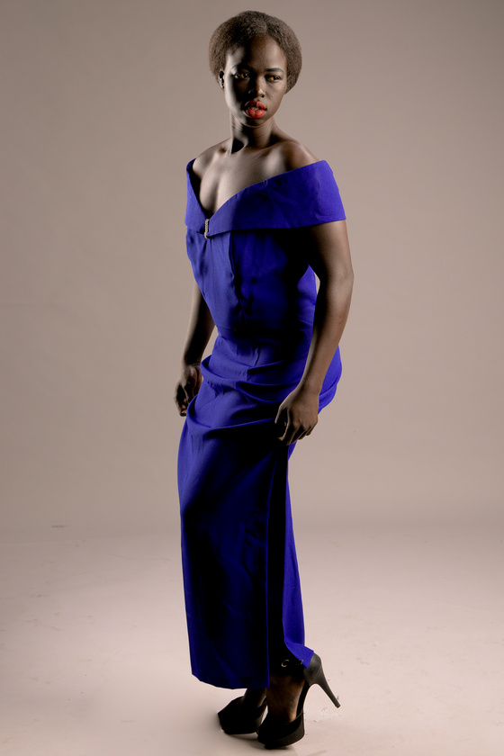 Kimmy melbourne sudannese fitness model in a purple dress