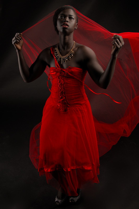 Kimmy melbourne sudannese fitness model in red dress dancing