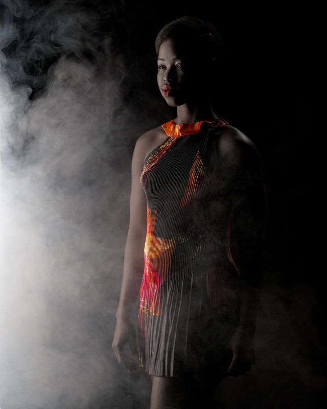 Kimmy melbourne sudannese fitness model in studio wearing a black dress in smoke