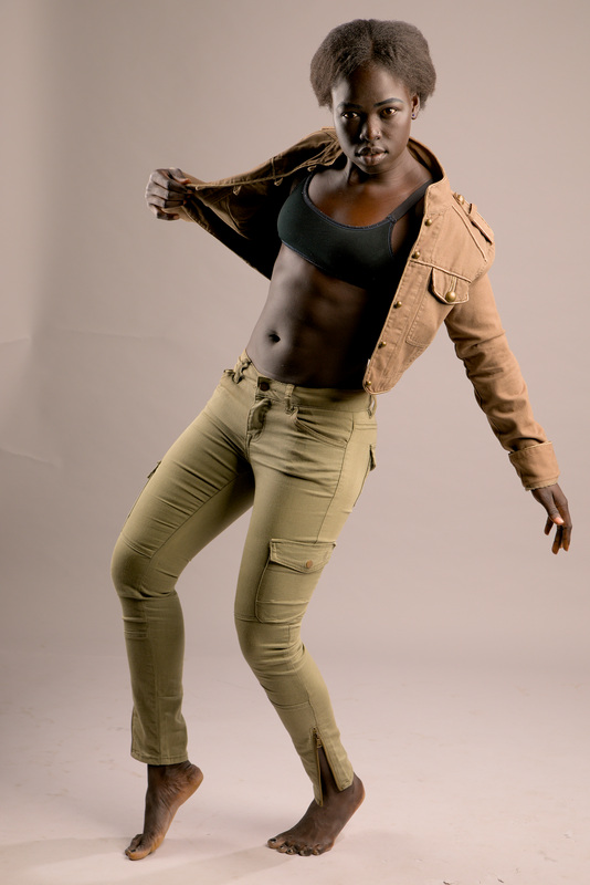 Kimmy melbourne sudannese fitness model in studio wearing green jeans