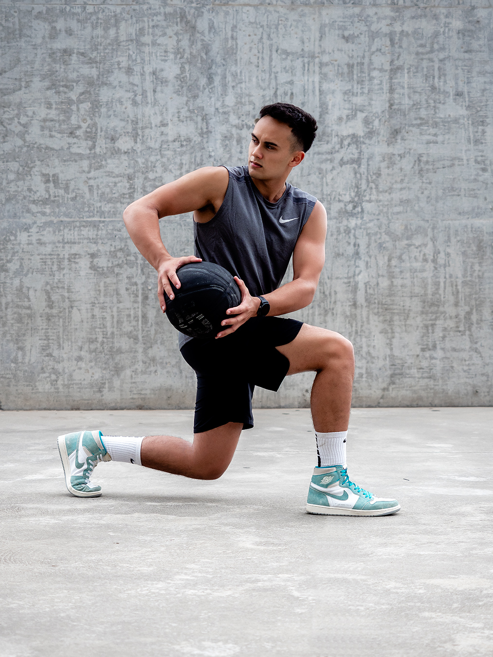 Professional formula one driver Luis lunging with medicne ball