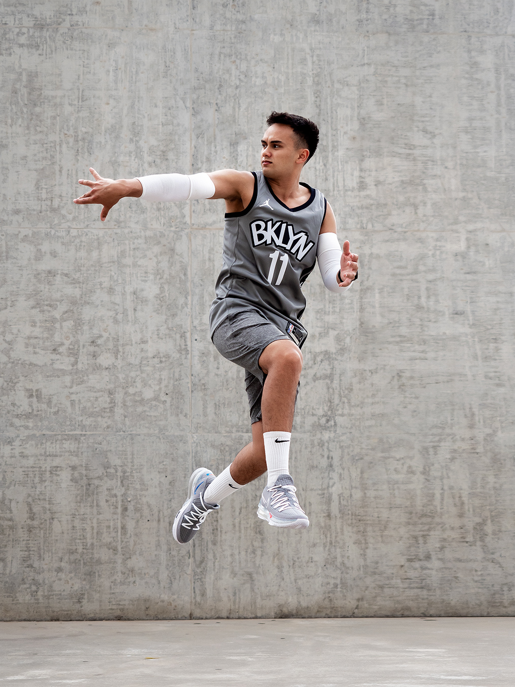 Professional formula one driver Luis passing the basketball mid air