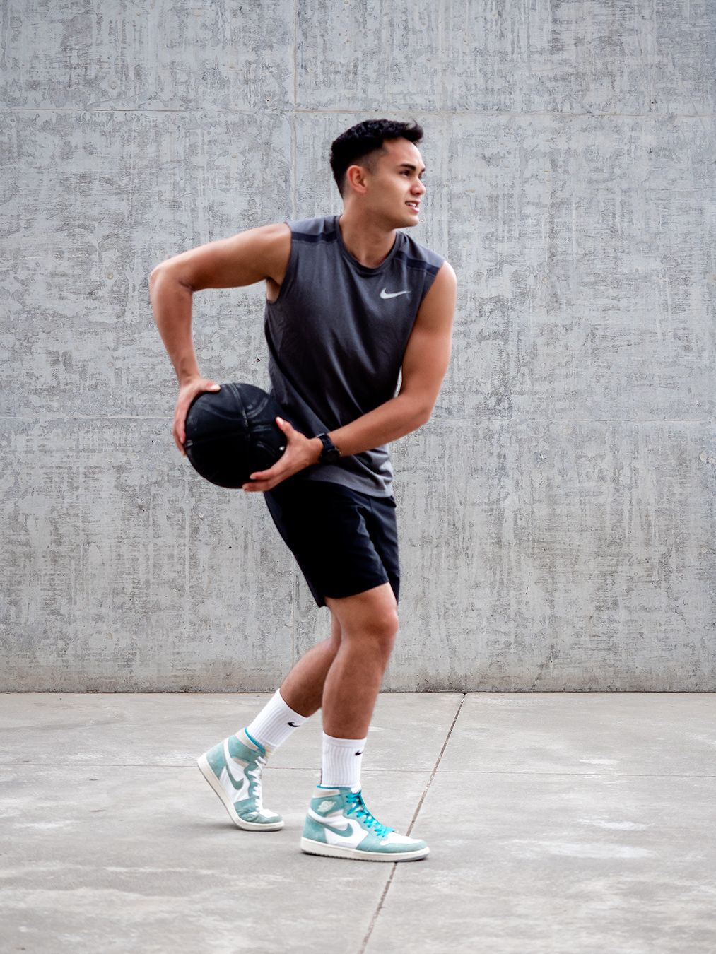 Professional formula one driver Luis performing basketball tricks