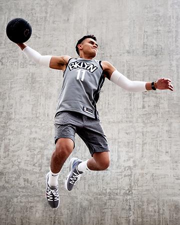 Professional formula one driver Luis slam dunking a basket ball