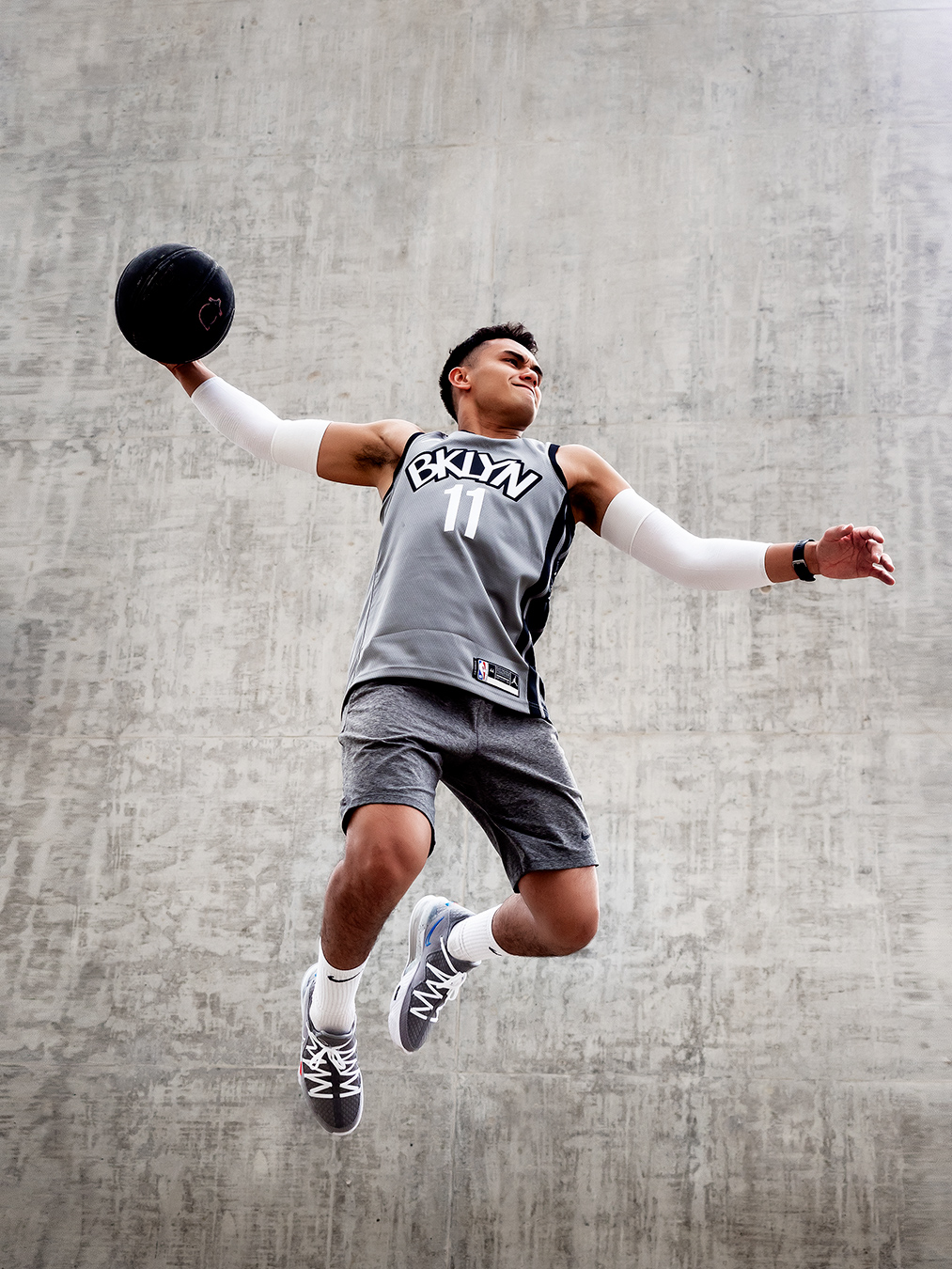Professional formula one driver Luis slam dunking a basketball