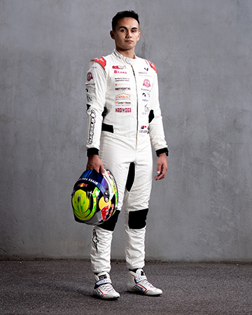 Professional formula one driver Luis wearing a full protective formal one suit