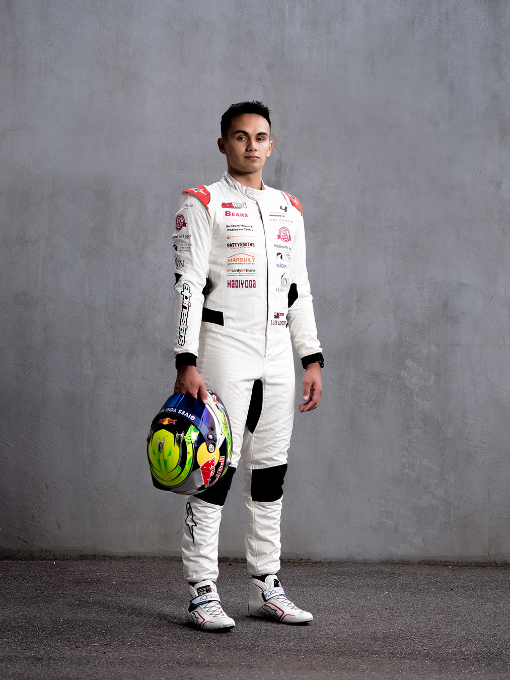 Professional formula one driver Luis wearing his driving protective gear